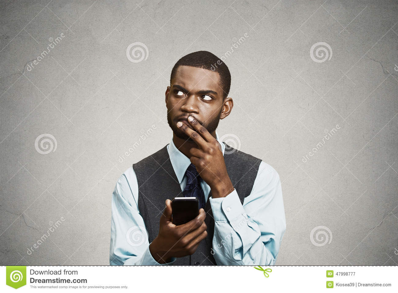 Confused executive thinking how to reply to message on smart phone