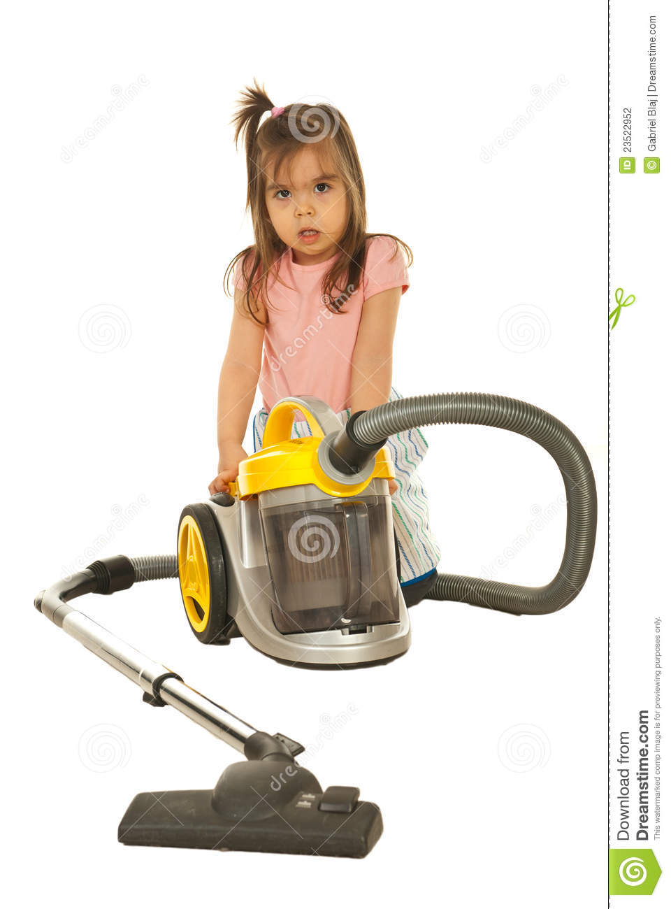 Confused Little Girl With Vacuum Cleaner Stock Photo