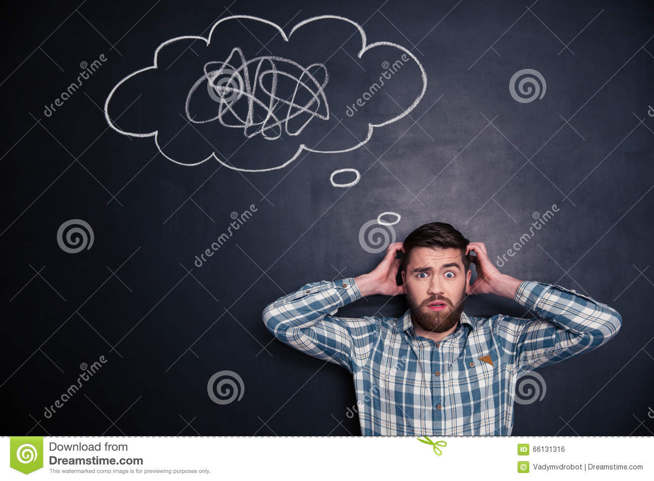 Confused man thinking about problem with black board behind him
