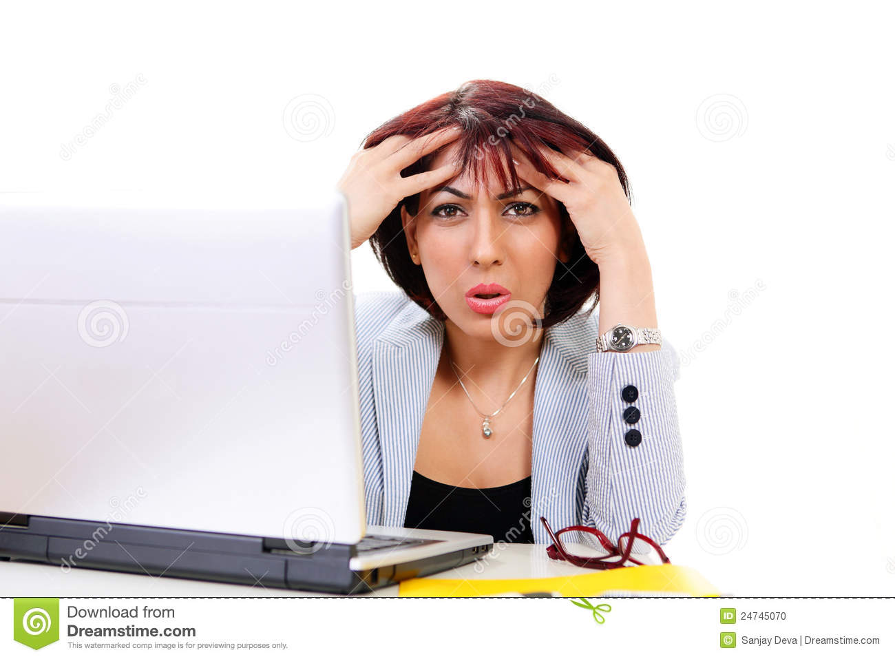 Confused office lady holding head sitting before computer.