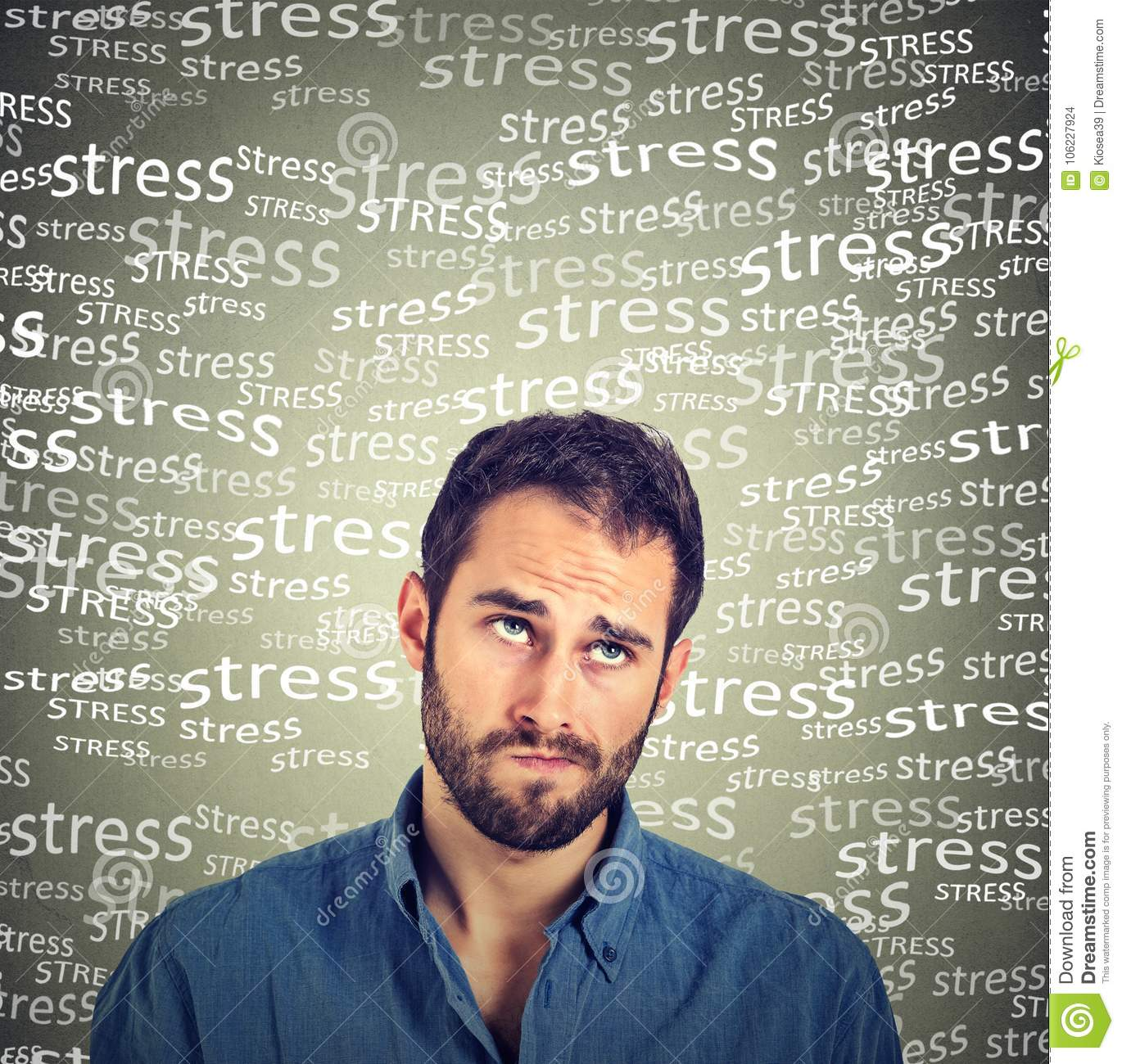 Confused skeptical young man thinking looking up under stress pressure