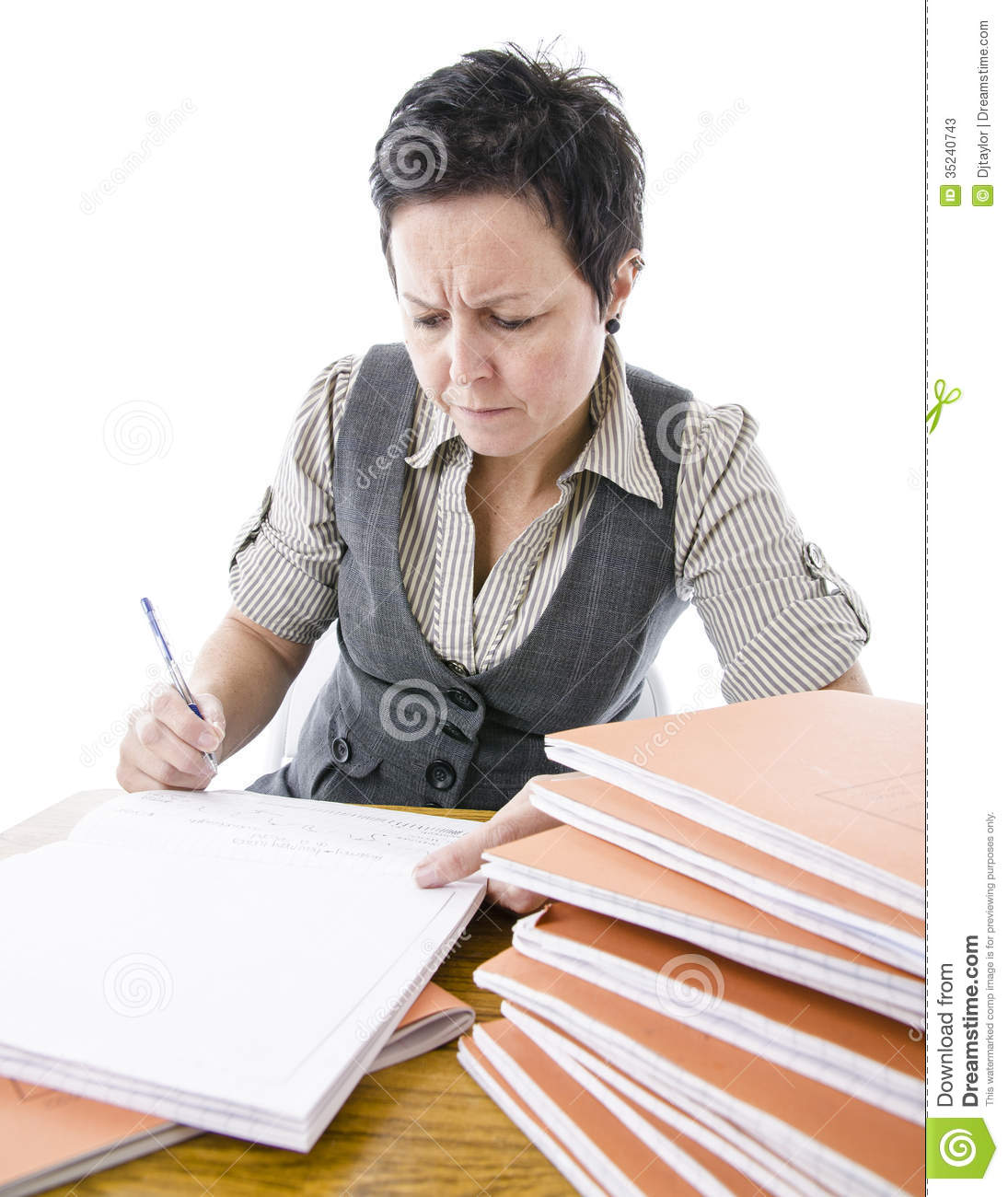 Confused Teacher Marking Students Work Stock Photos