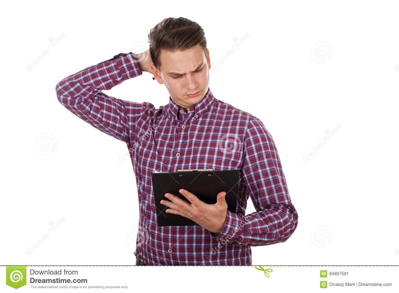 Confused young guy reading a document