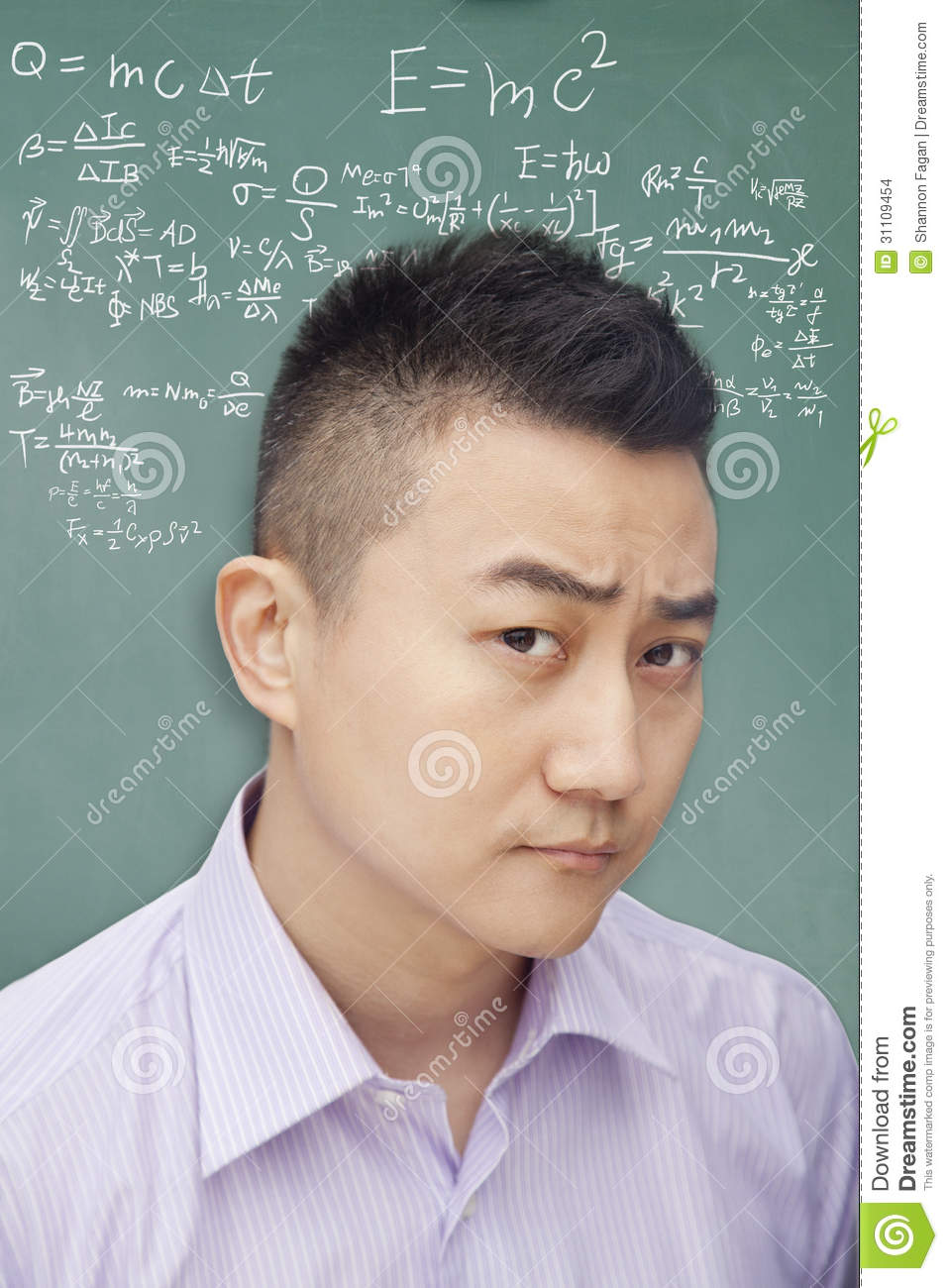 confused young student in front of blackboard with math equations
