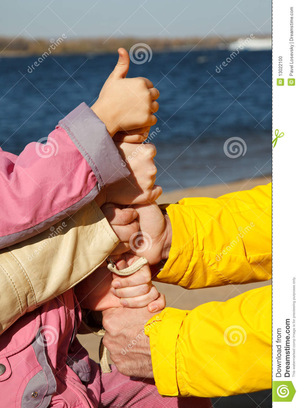 Connected Hands Of Family As Symbol Of Unity Stock Photo 13022100 Megapixl