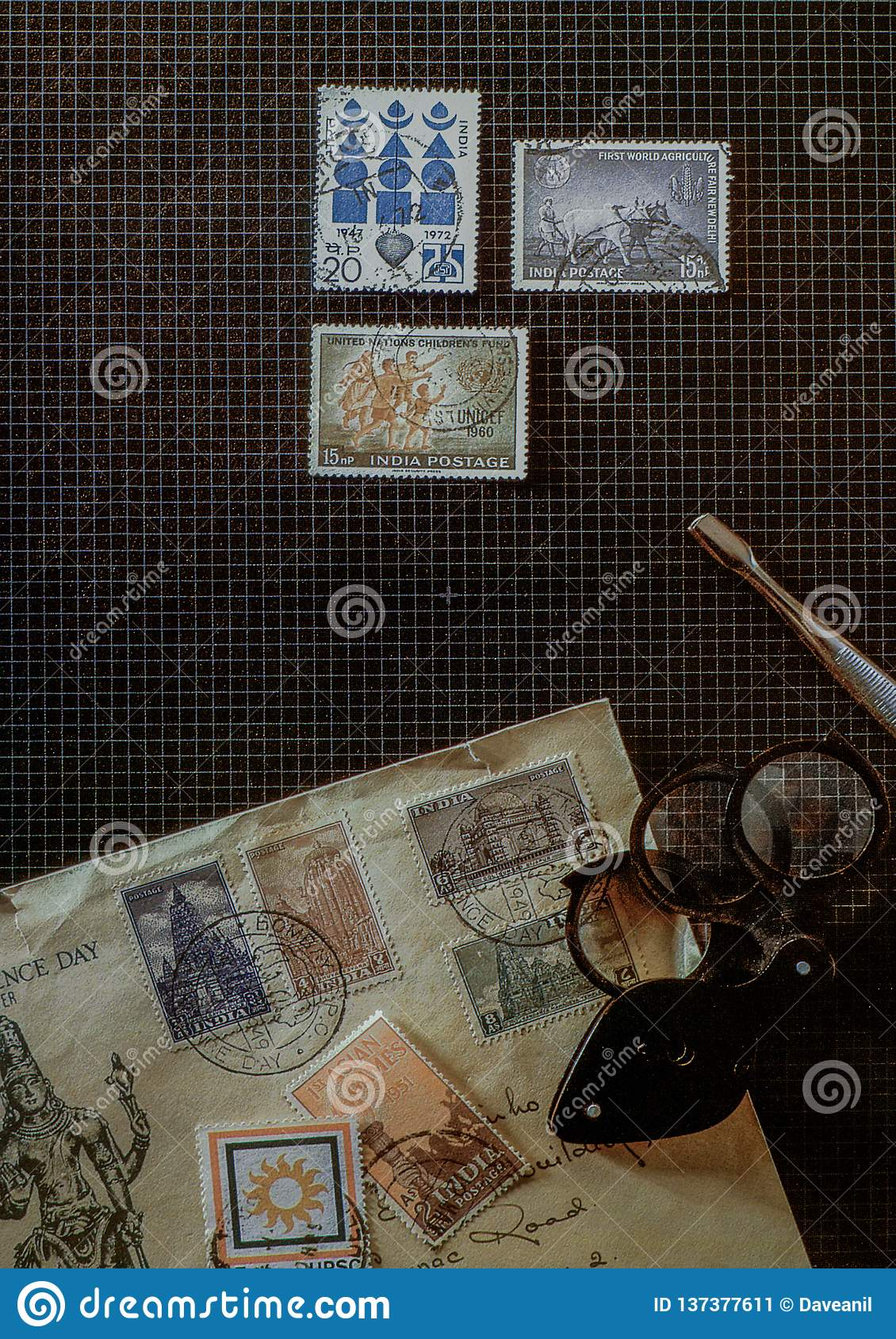 Concept philately postage stamps collectors tools on desk