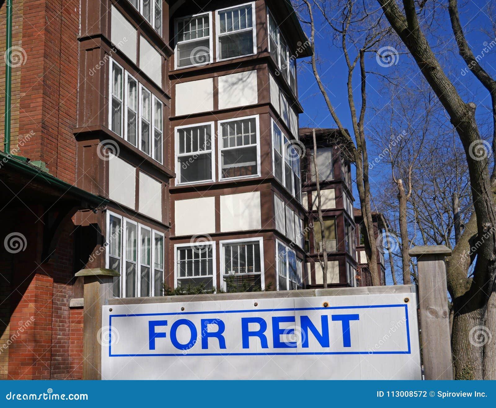 Construção com para sinal do aluguel