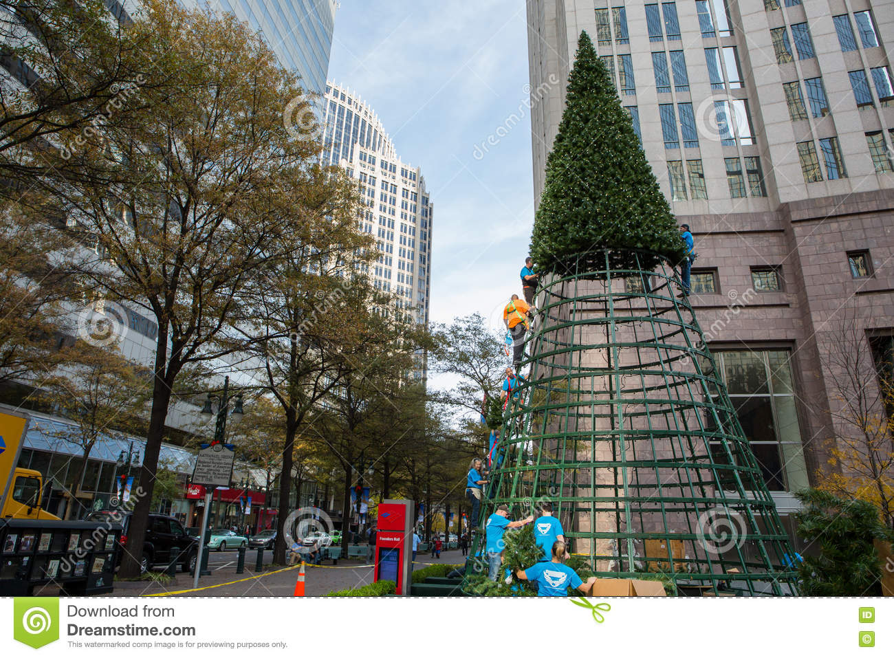 charlotte nc november 25 2016 a crew assembles a large christmas tree in front of bank of america corporate center in uptown charlotte