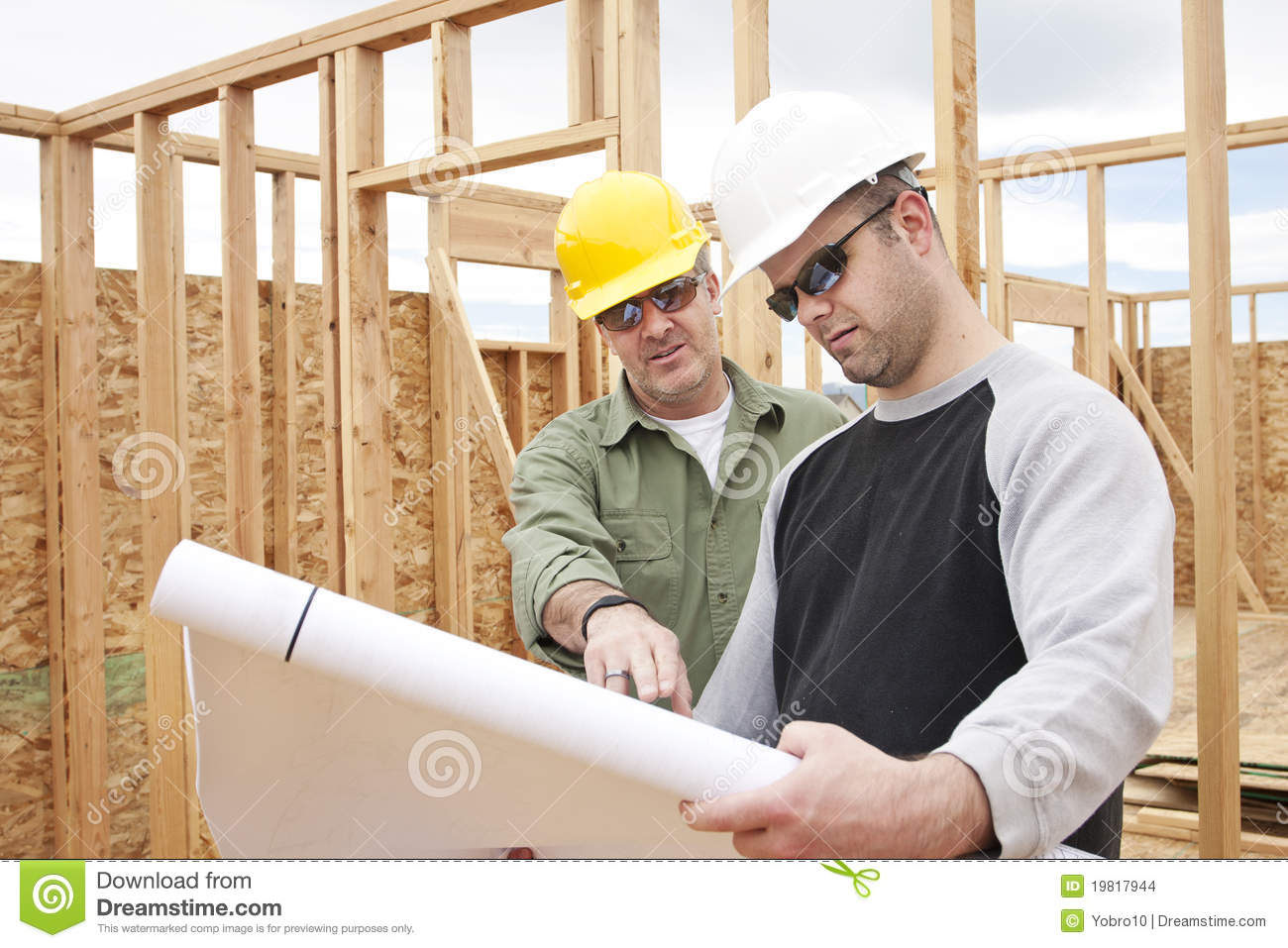 Construction Contractors Building A New Home Stock Images