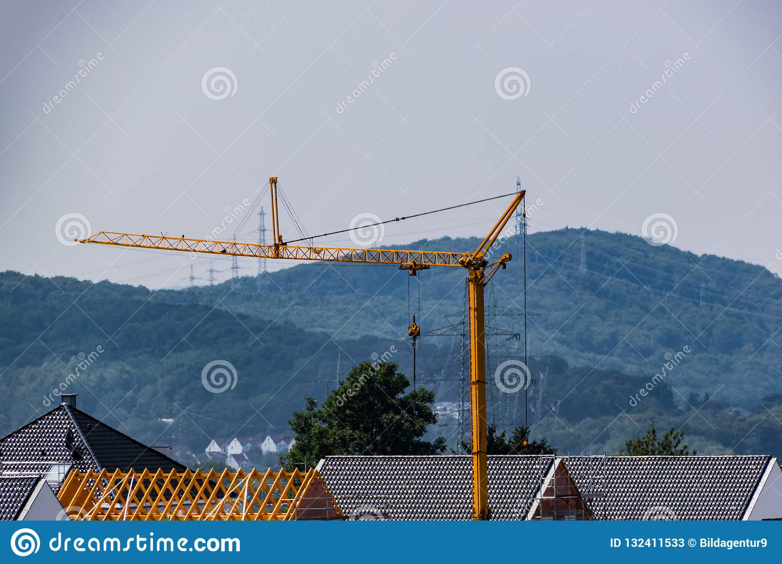 Construction crane over the roofs of the city