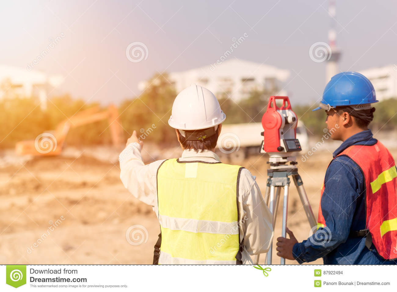 Construction engineer and foreman worker checking site