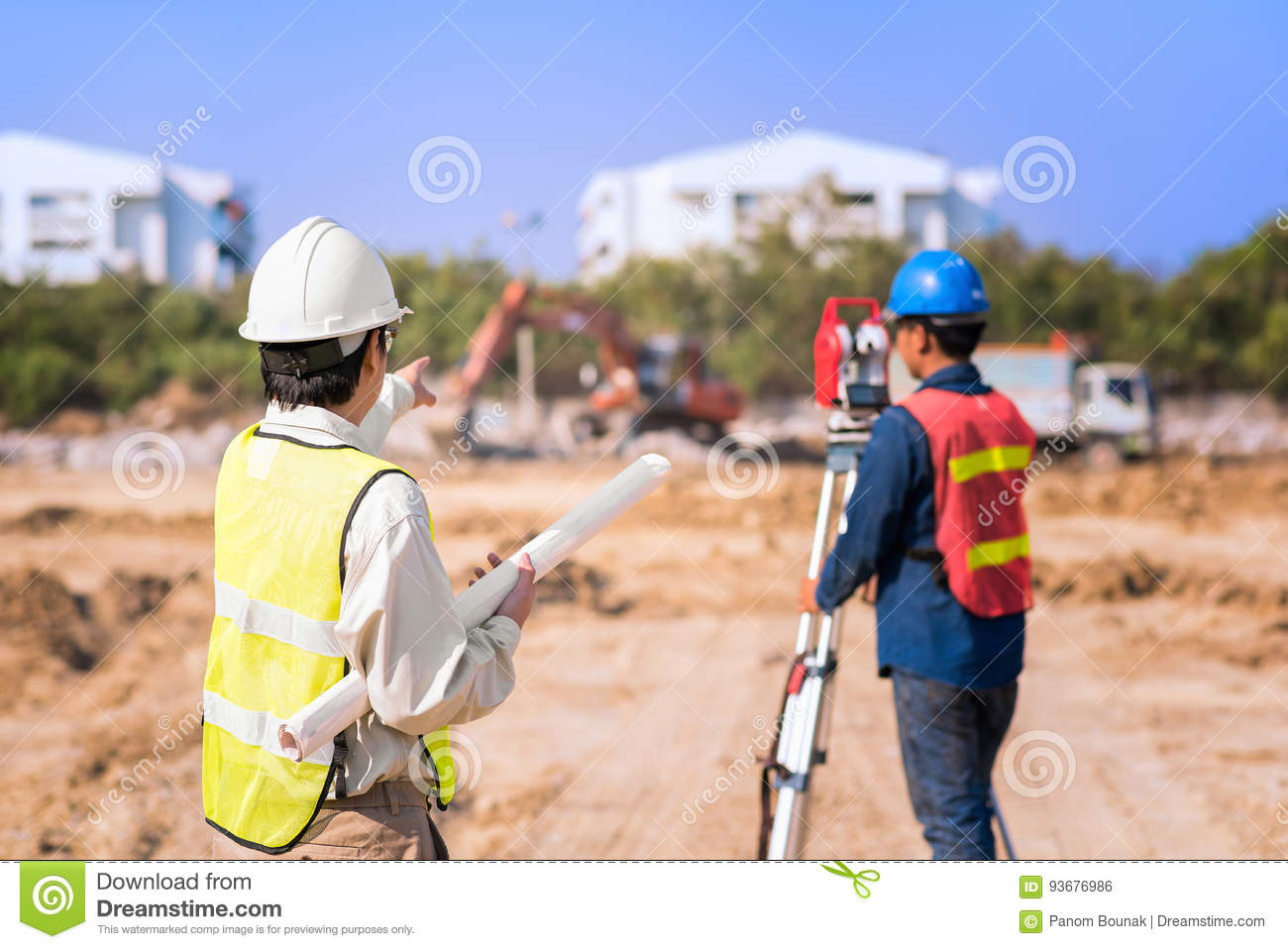 Construction engineer with foreman worker checking site