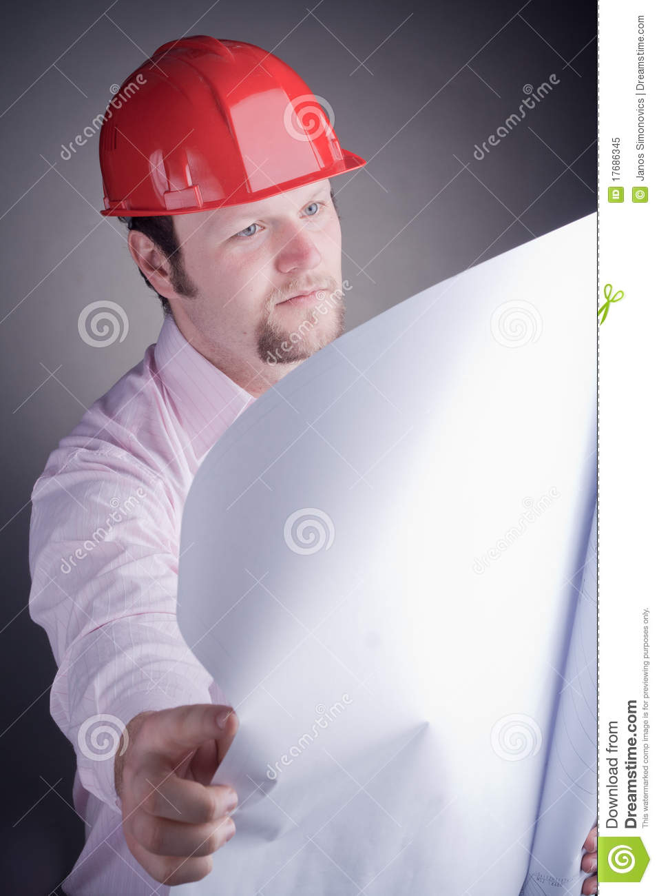 Construction engineer surveying the open project