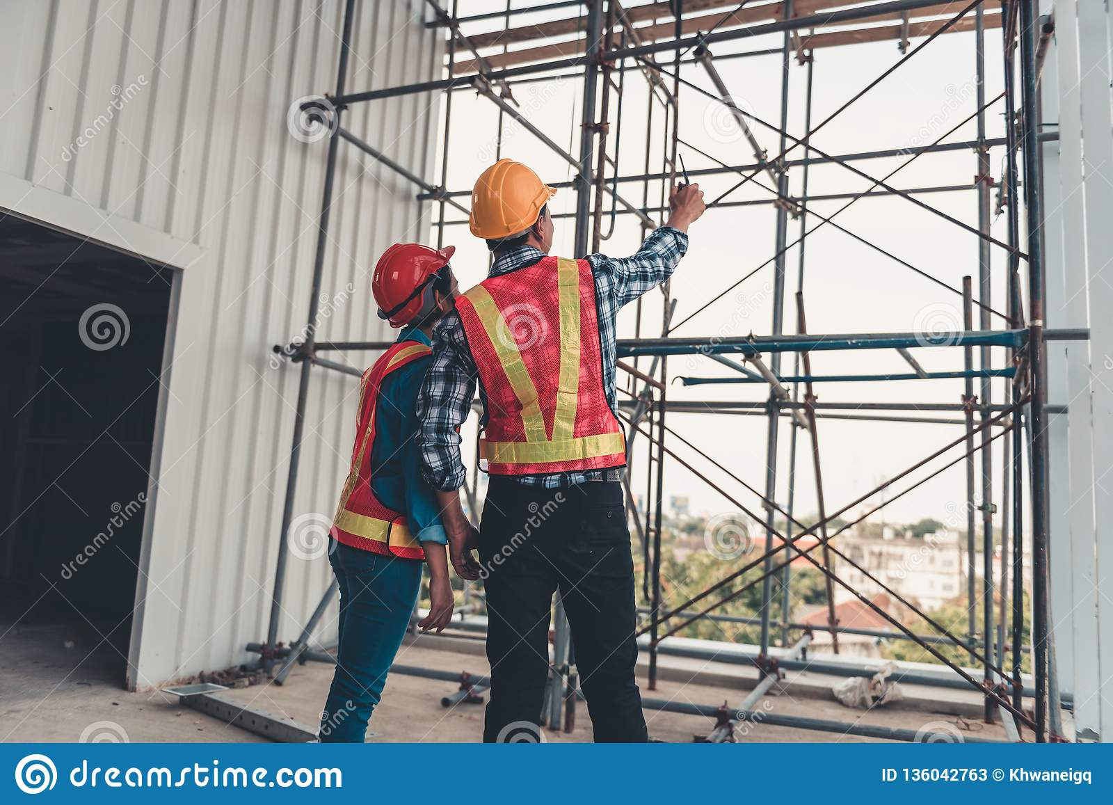 Construction engineer teamwork are inspection site constructing and installation steel scaffolding platform., Project manager and