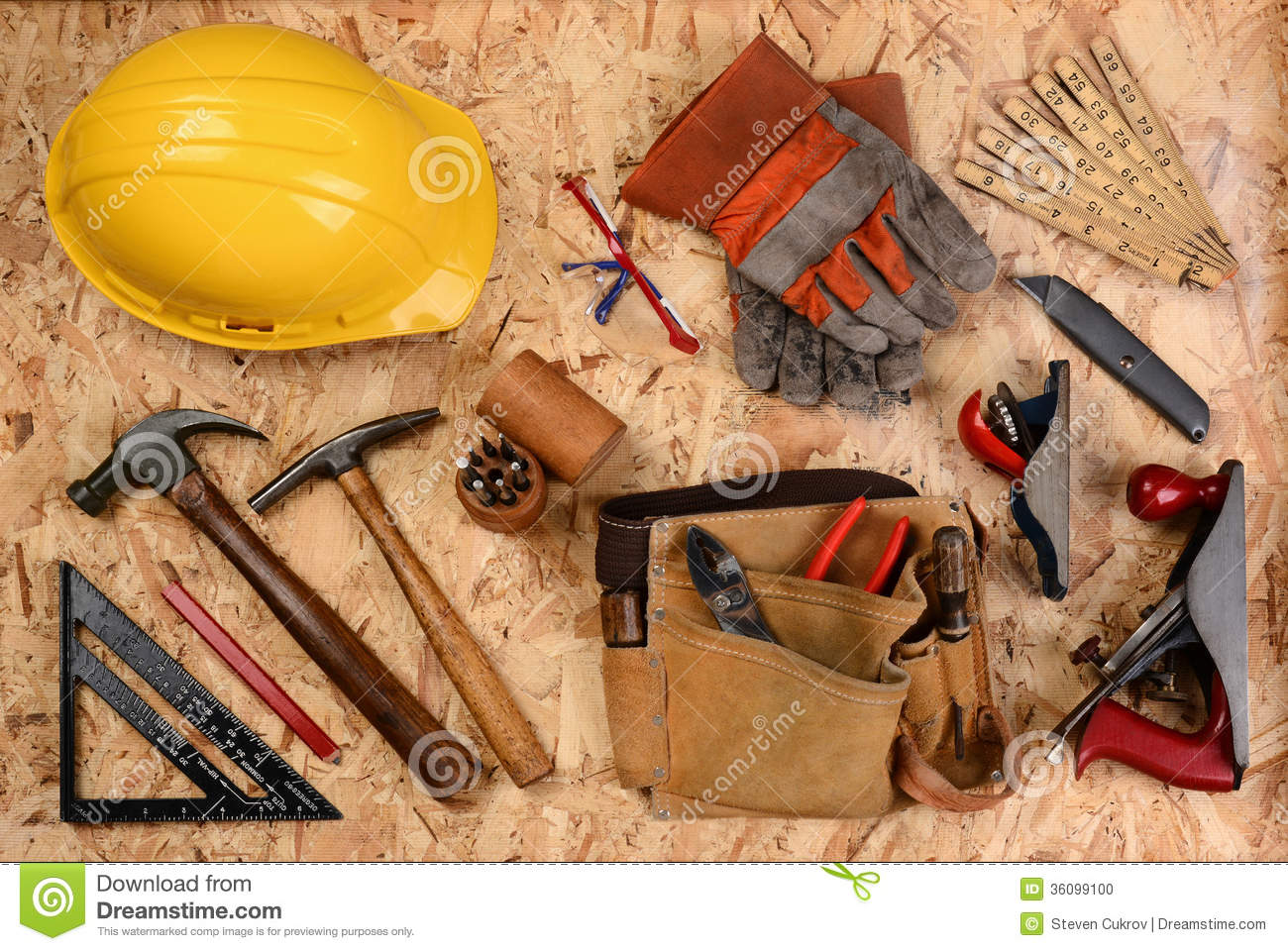 Overhead View Of Construction Equipment And Tools Laid Out On A Sheet