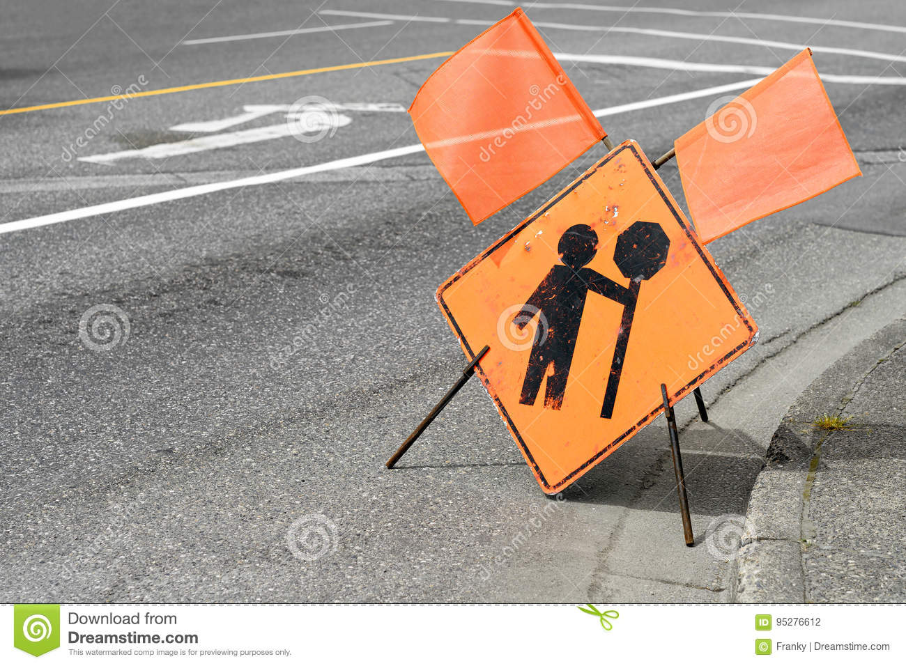 Construction flagger ahead sign