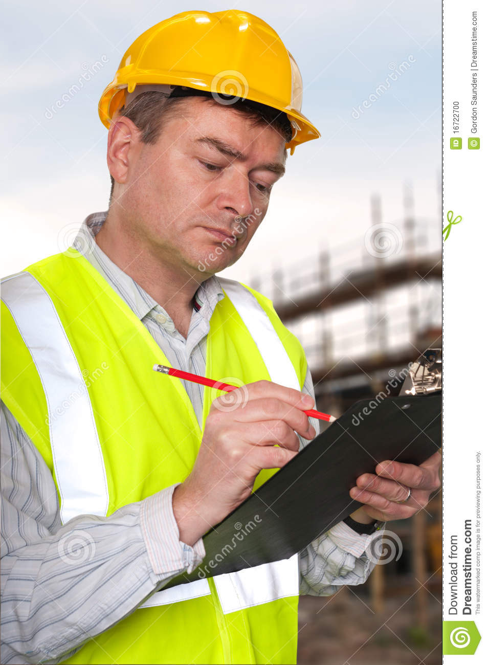 Construction foreman checks clipboard stock photo image for Builder contractors
