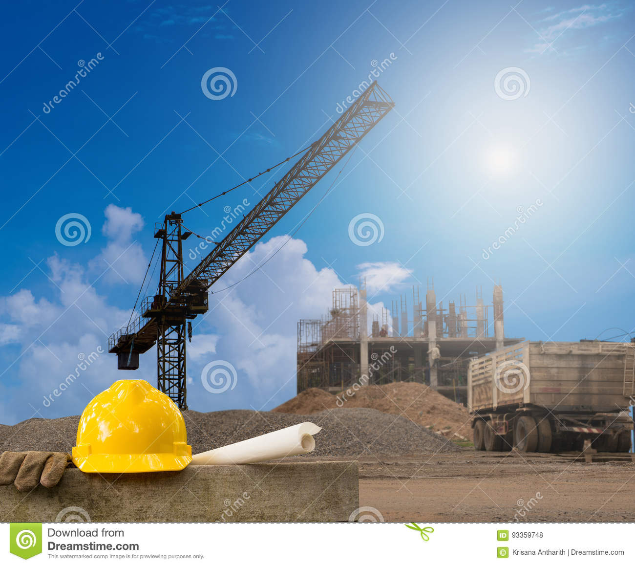 Construction industry building on high ground with yellow helmet