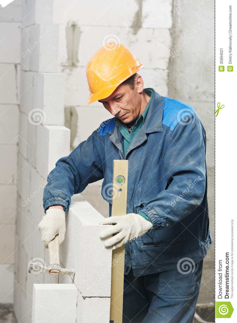 Calcium Silicate Brick Chipped : Construction mason worker bricklayer with level stock