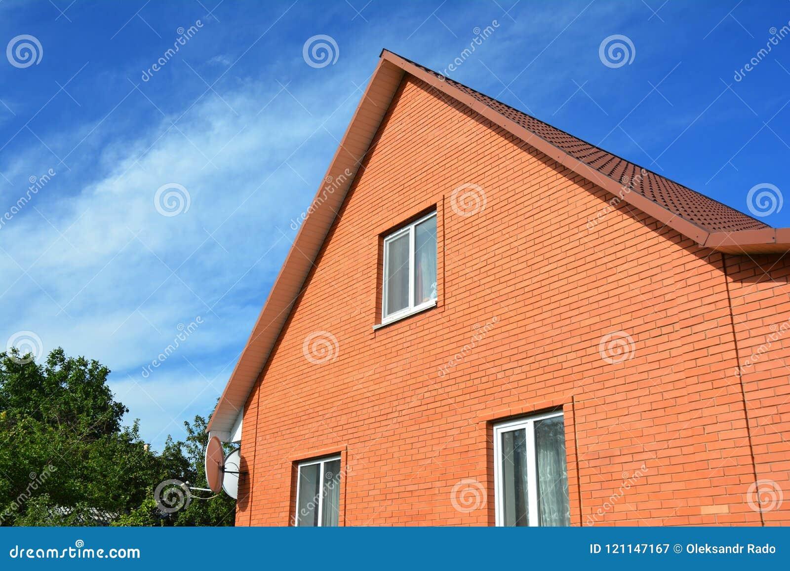 construction maison en brique rouge ventana blog. Black Bedroom Furniture Sets. Home Design Ideas