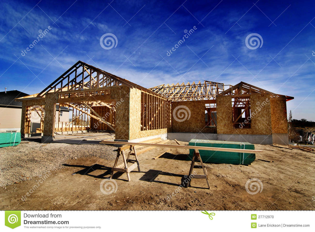 Construction of new home in subdivision stock photo for New home structure
