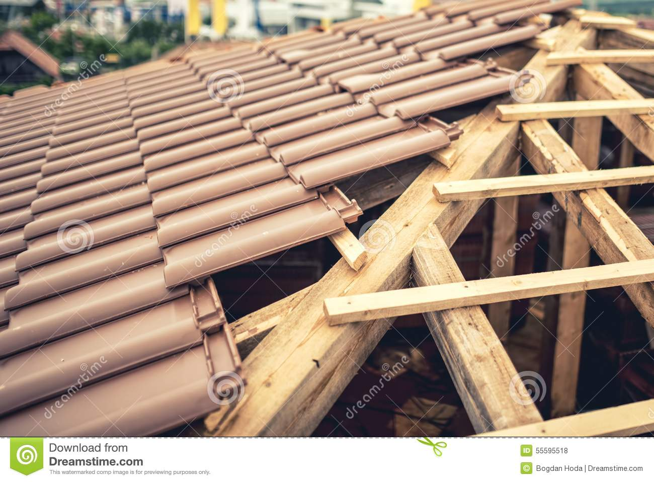 House Tiles roof under construction with stacks of brown, modern tiles