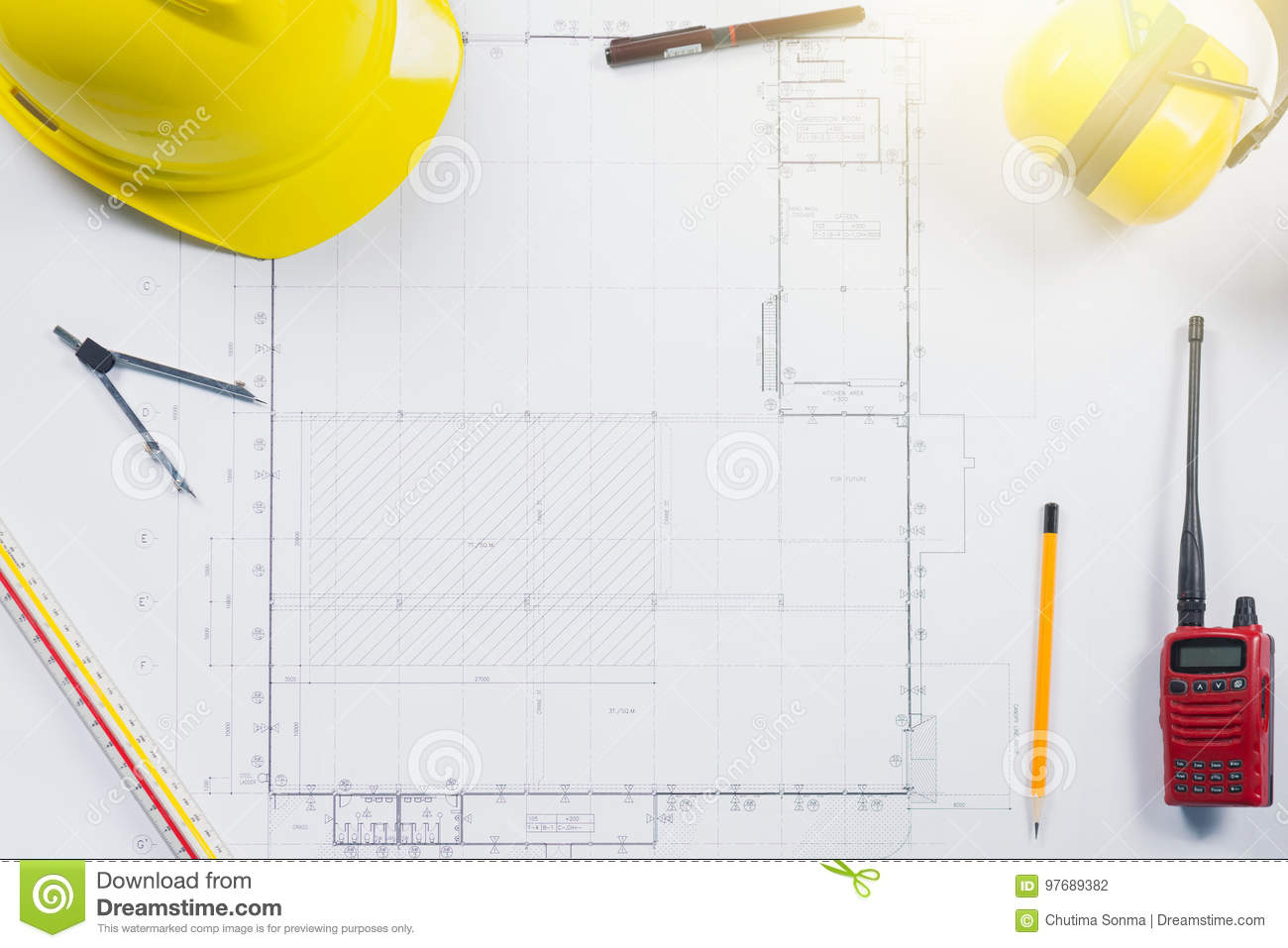 Construction Plans With Yellow Helmet And Drawing Tools On Blueprints At  Office