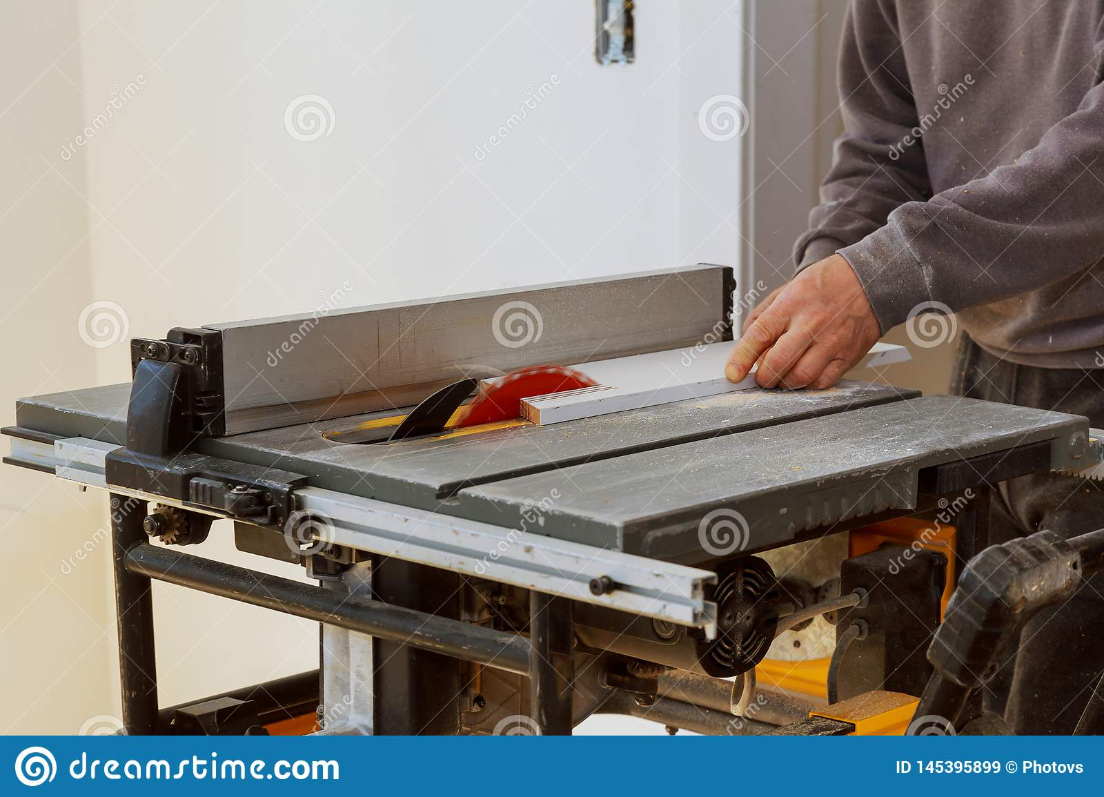 Construction remodeling home cutting wooden trim board on with circular saw