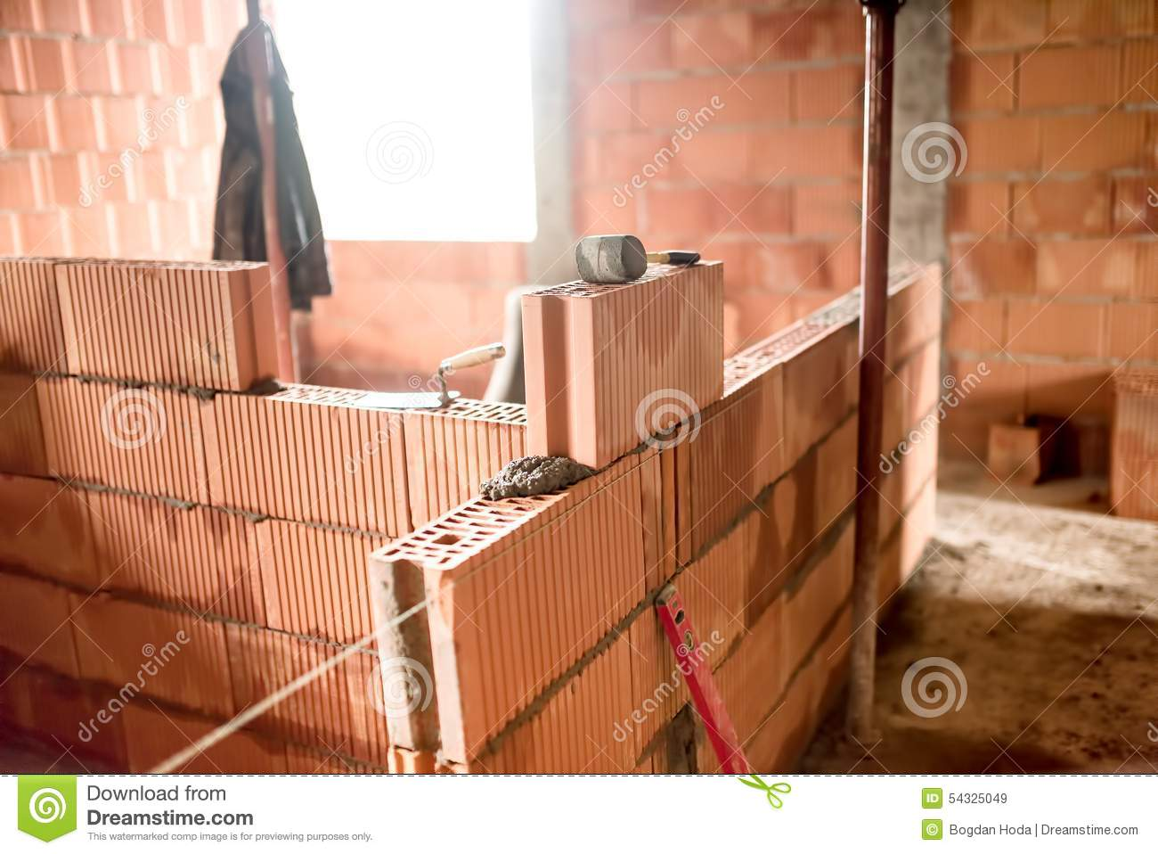 Construction Site With Bricklayer Building New House With Brick Walls Interior Rooms Stock