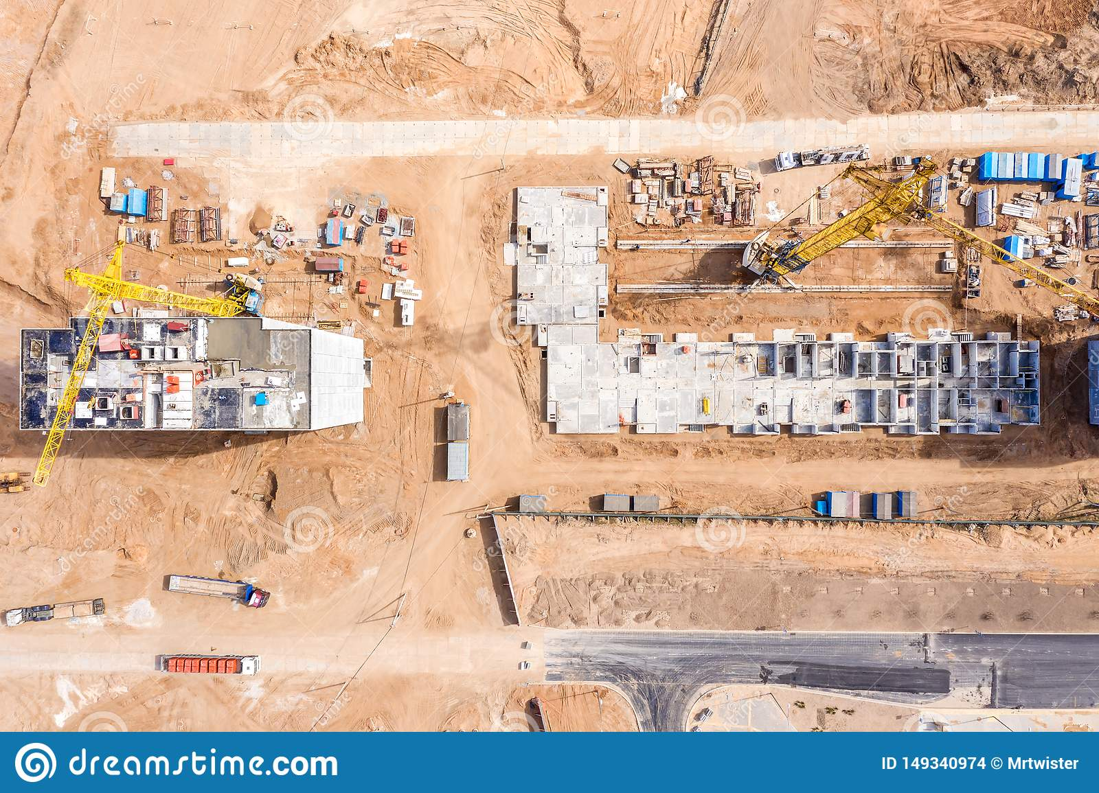 Construction site with building tower cranes. development of new residential area