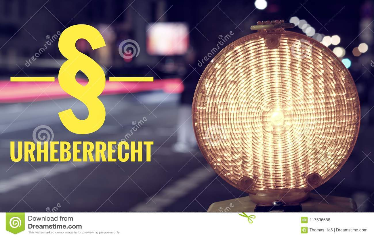 Construction site lamp and traffic at night with the inscription in german § Urheberrecht in english clarification of copyright