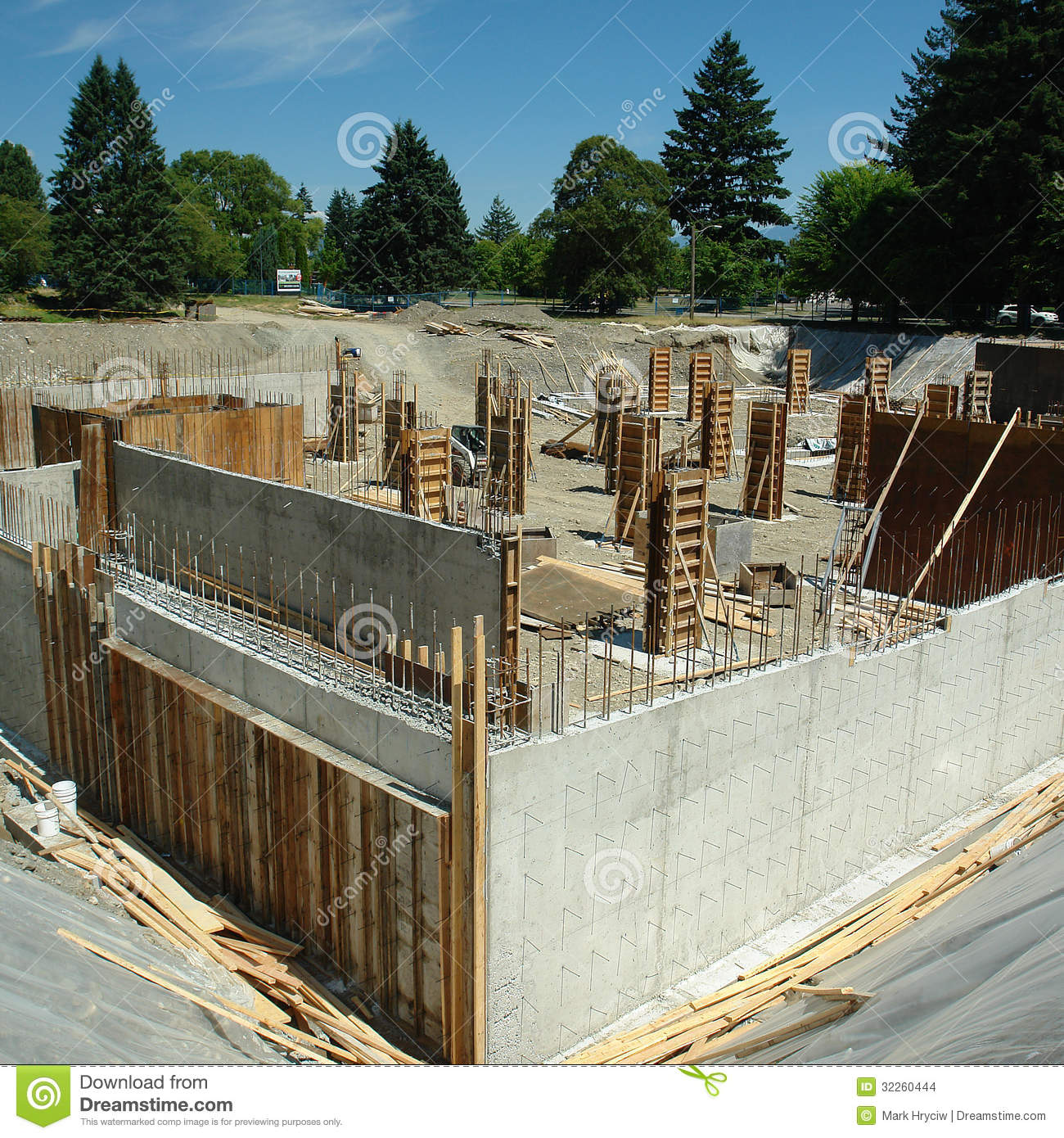 Construction site stock photo image of rebar under for What is the cost of building a house in india