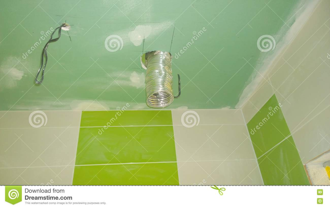 Construction work in the apartment, installation of tiles on the