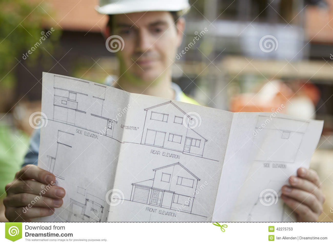 onstruction Worker On Building Site Looking t House Plans Stock ... - ^