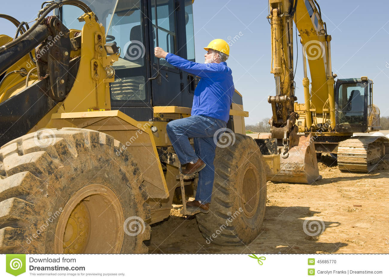 Construction Worker Climbing Heavy Equipment