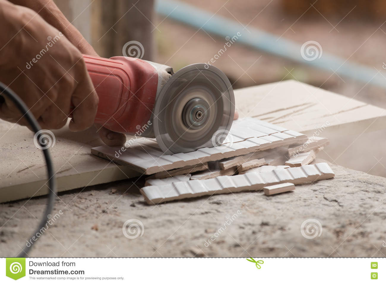Construction Worker Cutting A Tile Using An Angle Grinder Stock