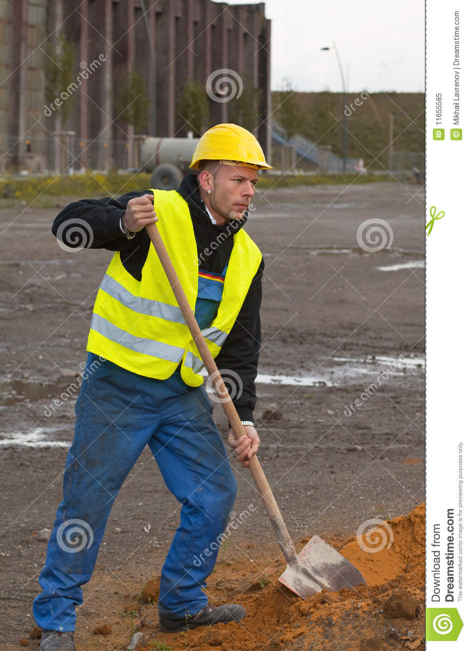 A shovel digging into pile stock image for Digging ground dream meaning
