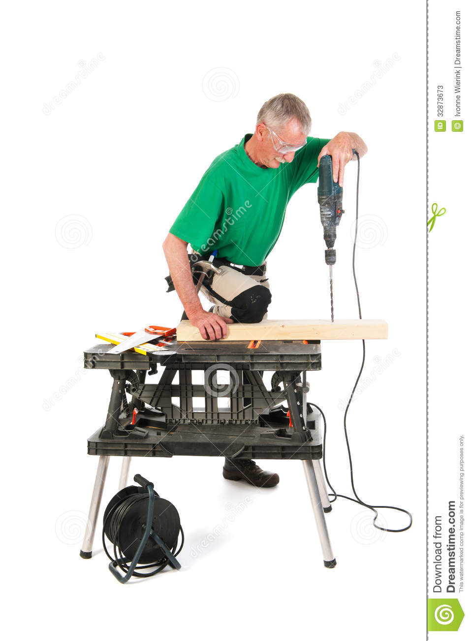 Construction Worker Drilling A Hole Stock Photos - Image ...  Construction Wo...