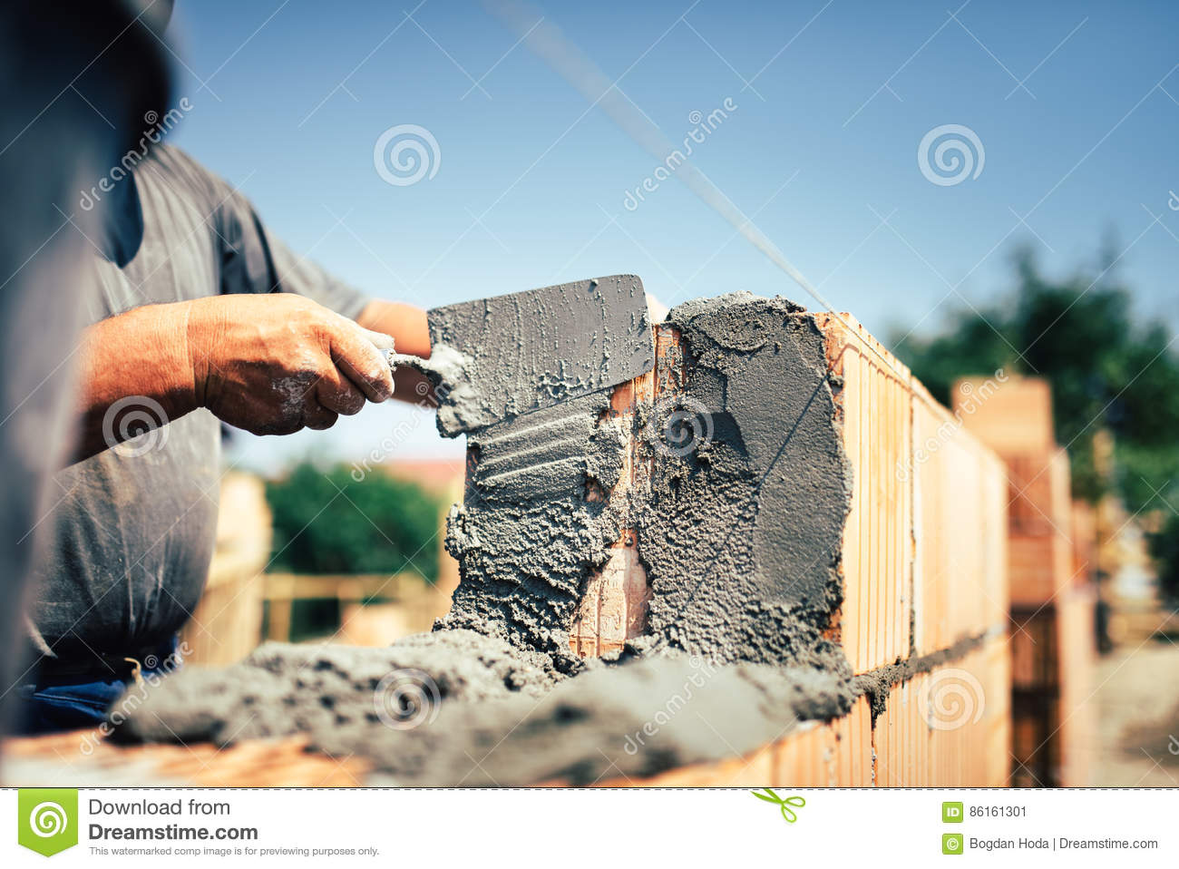 Construction Worker Installing Brick Masonry On Exterior Wall With Wiring External Trowel Putty Knife