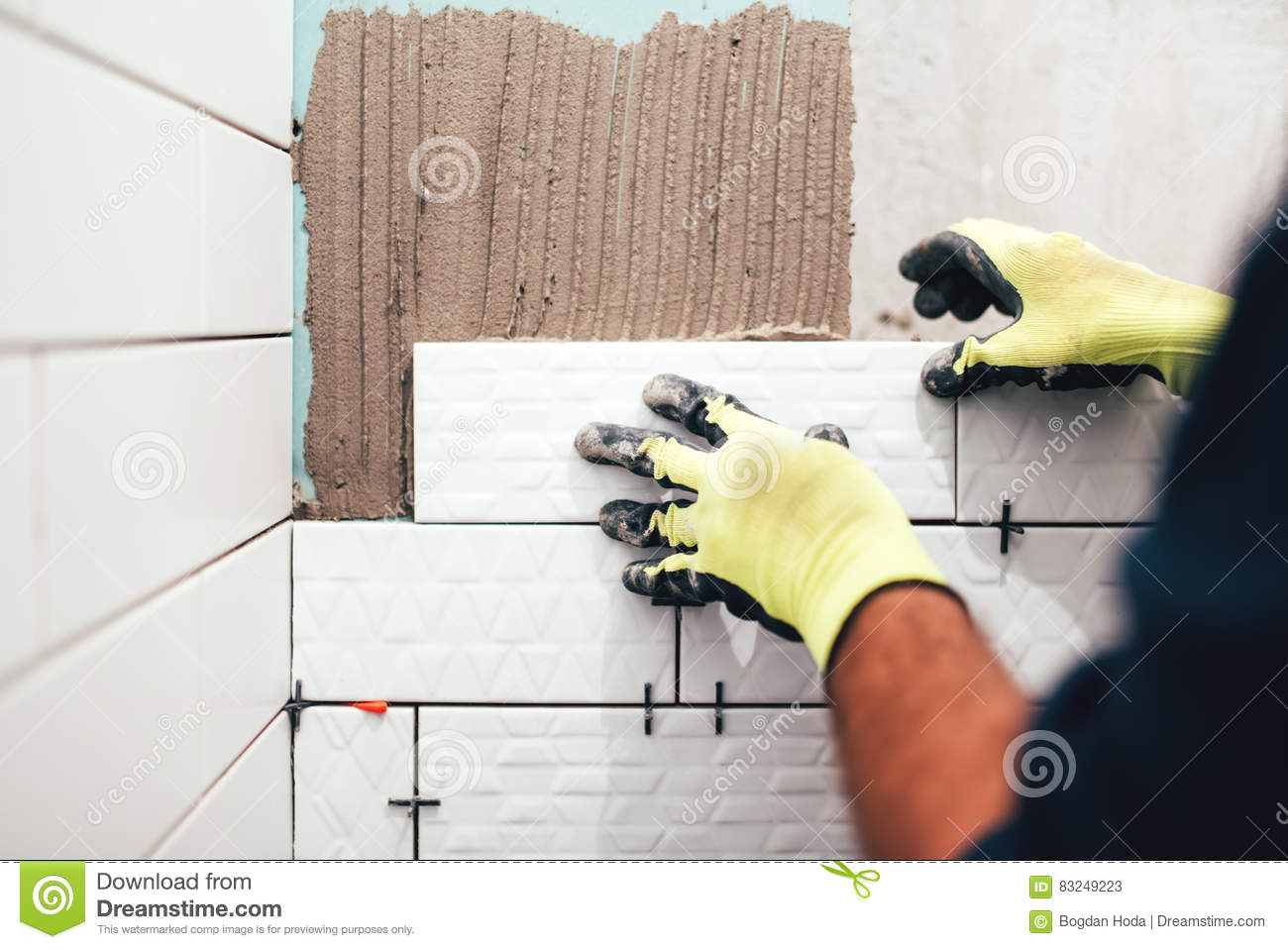 Construction Worker Installing Small Ceramic Tiles On Bathroom Walls ...