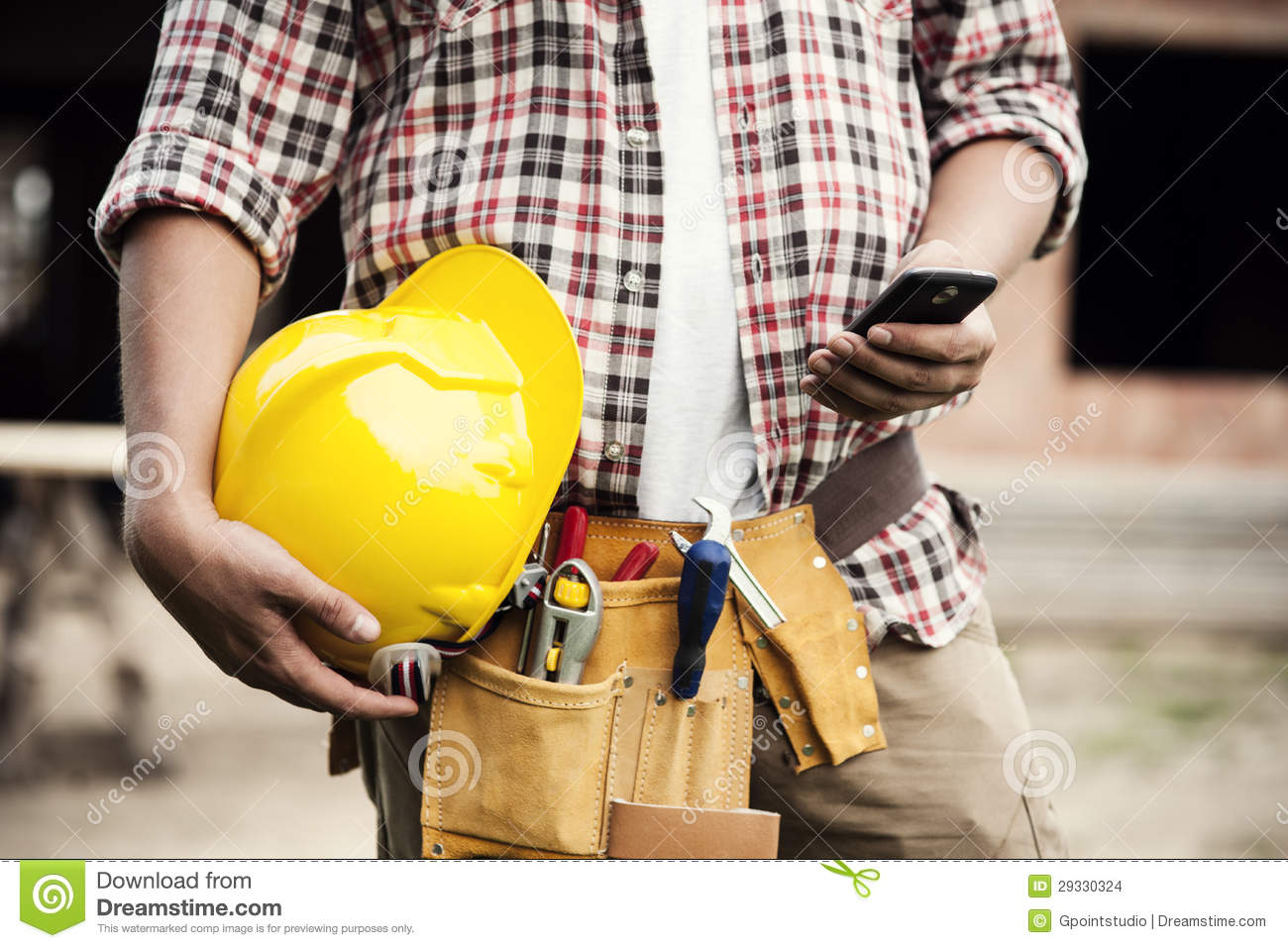 Construction worker with mobile phone