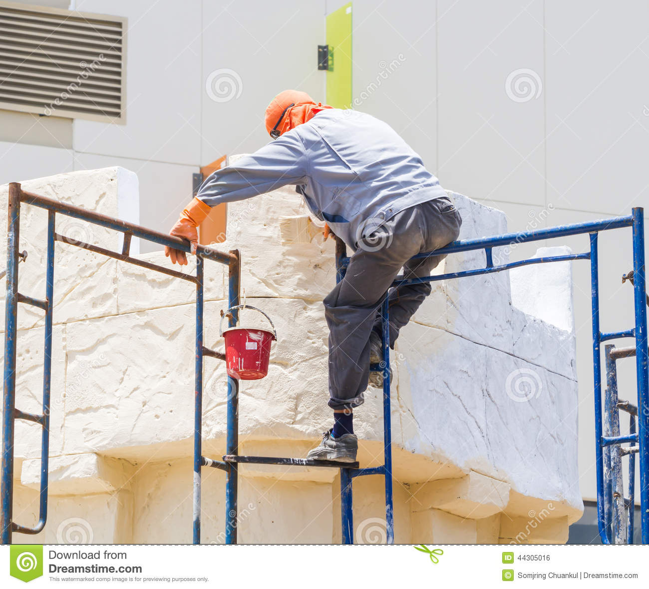 Interior Decorator Construction Worker Restoring And Painting Outside The
