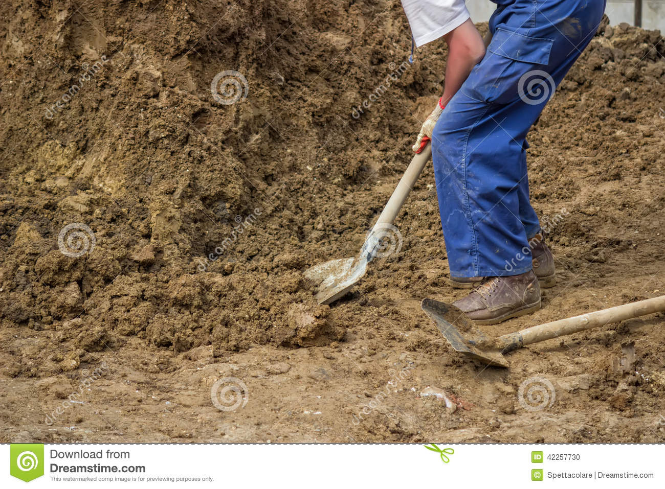 Construction worker shoveling dirt stock photo image of for Digging ground dream meaning
