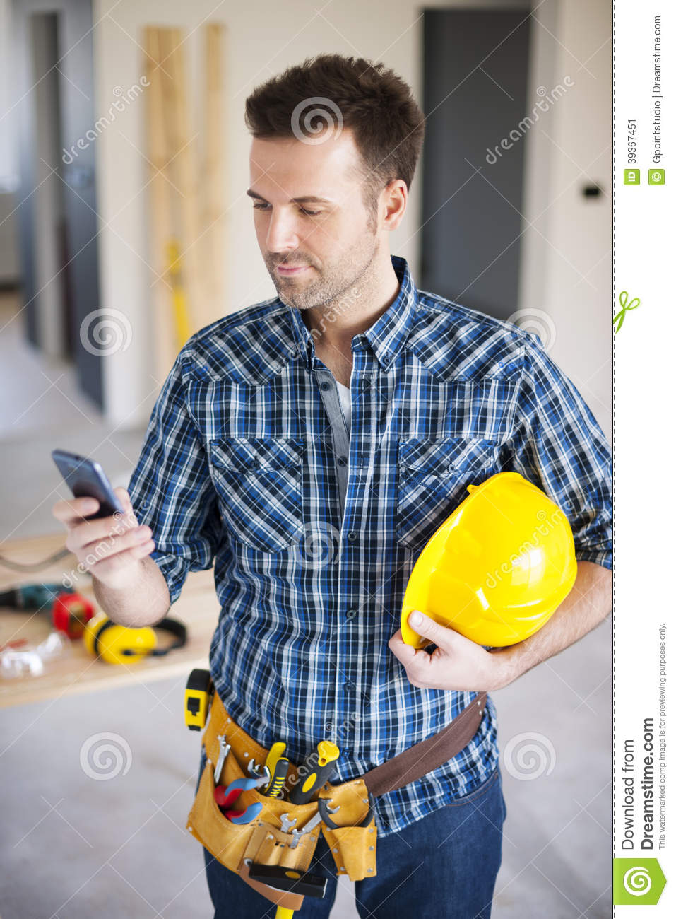 construction worker with smart phone stock image