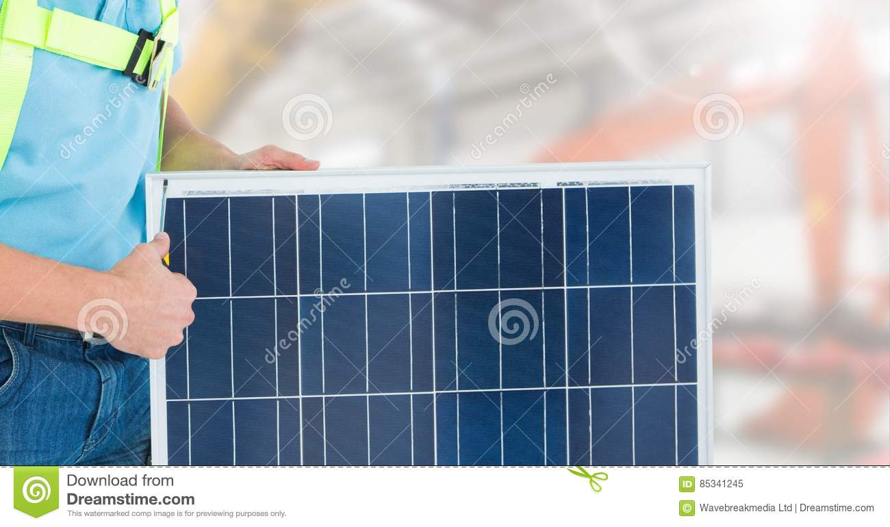 Construction worker standing with solar panel