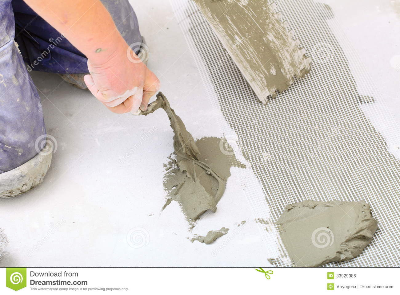Floor Tile Workers : Construction worker is tiling at home tile floor adhesive