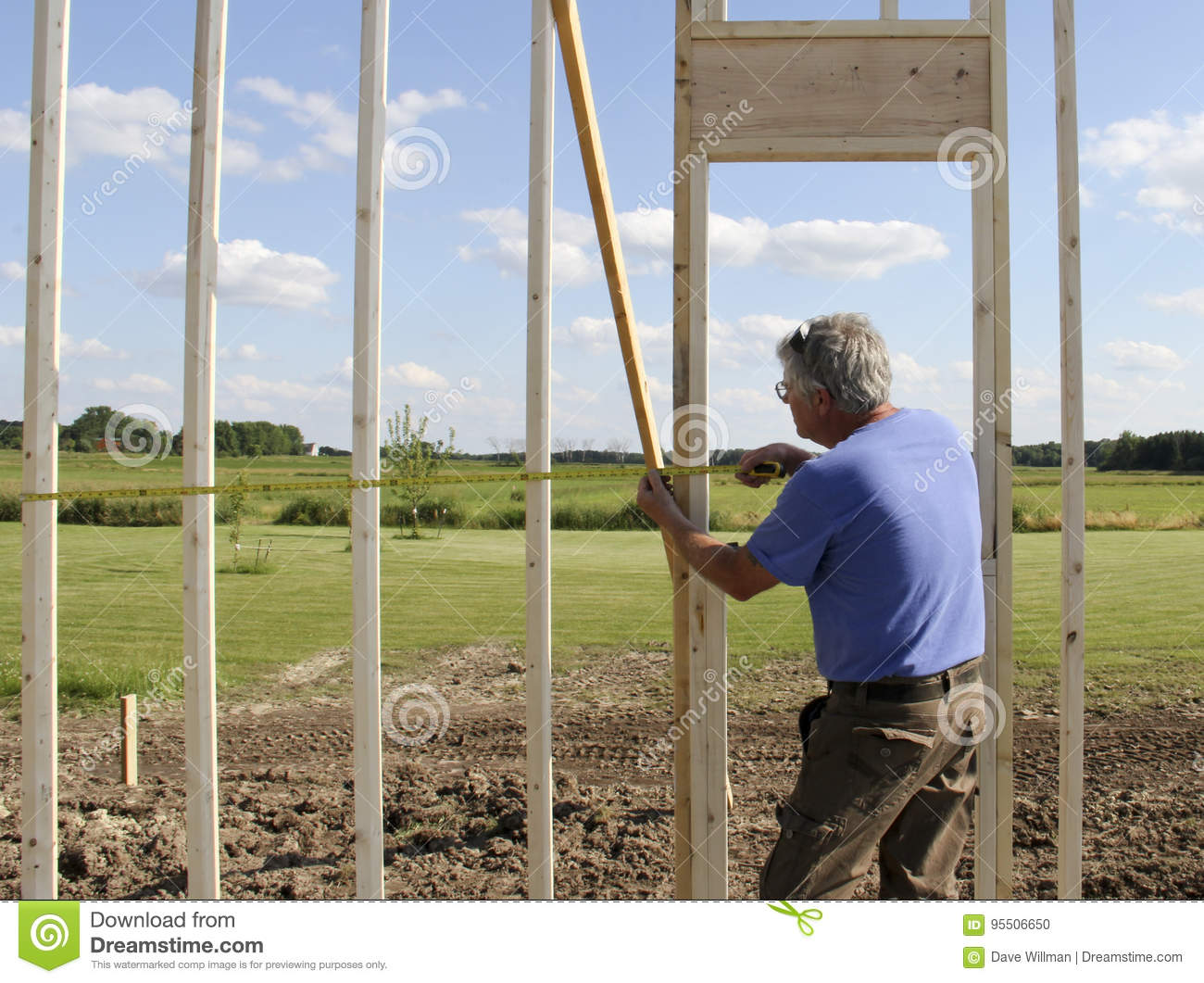 Construction Worker Using a Ruler
