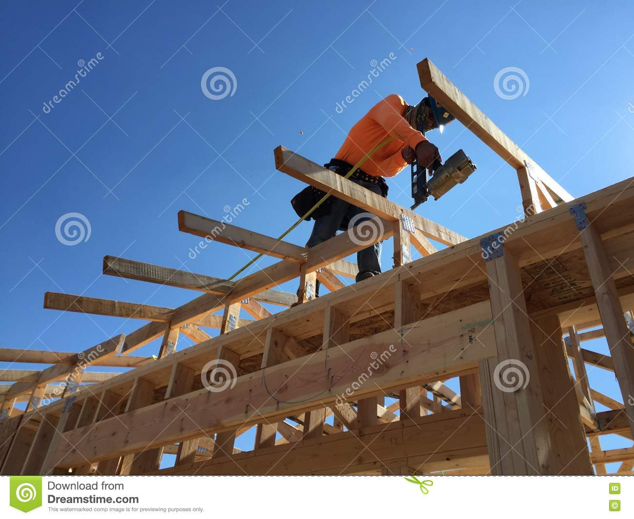 Construction worker working on the framing process for a for New construction building process