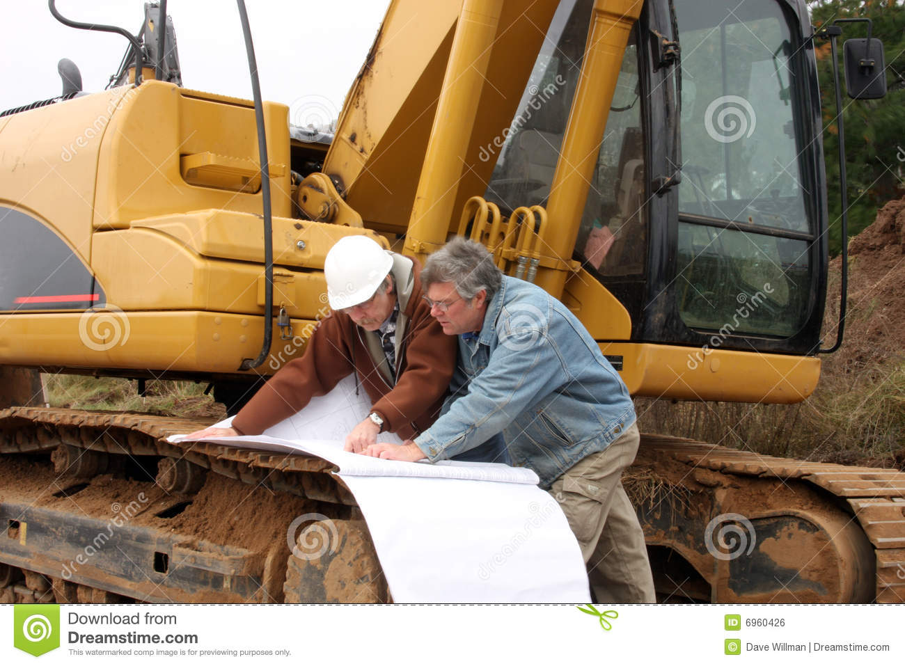 Construction workers with blue prints