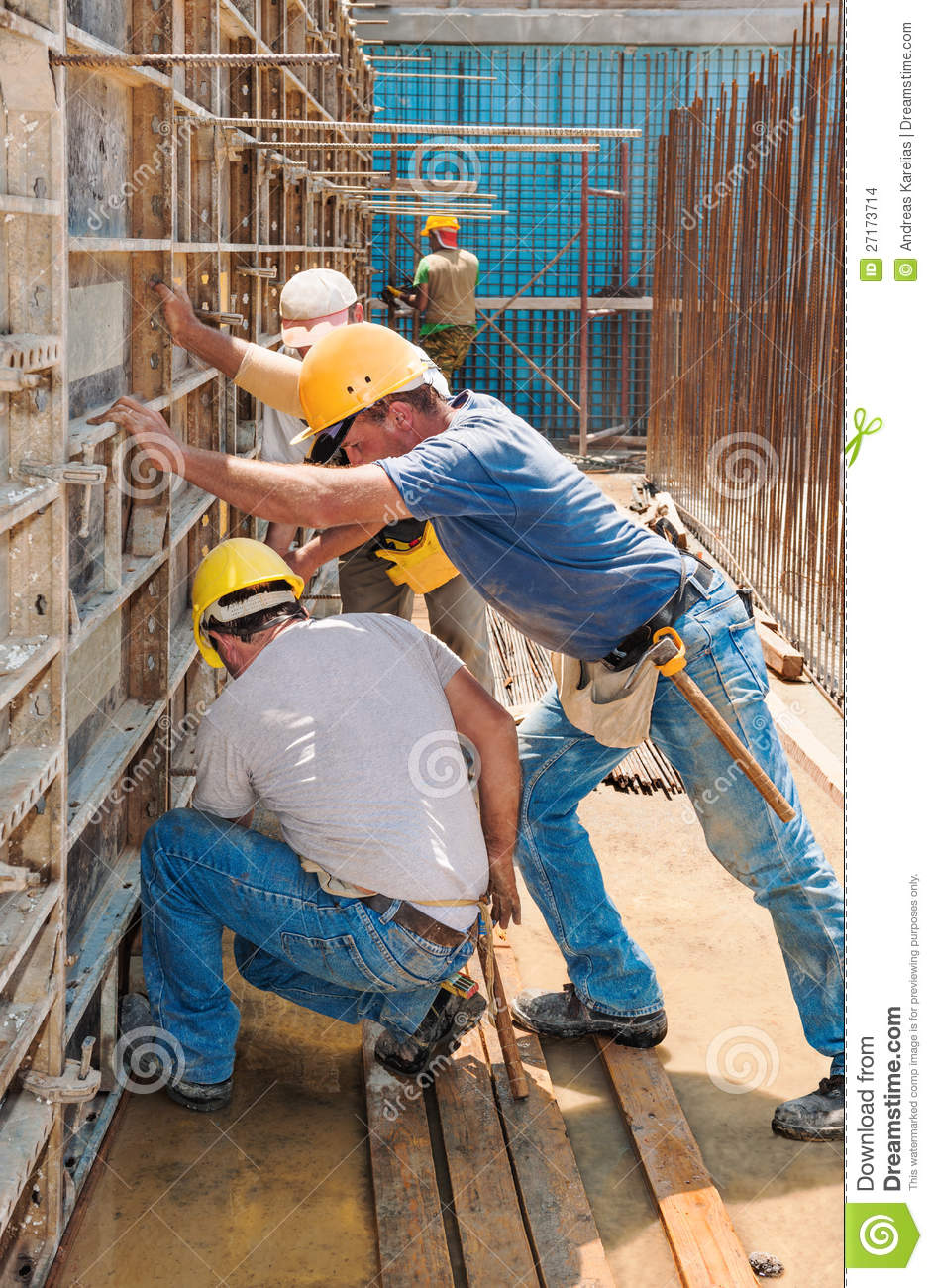 Construction Workers Busy With Formwork Frames Stock